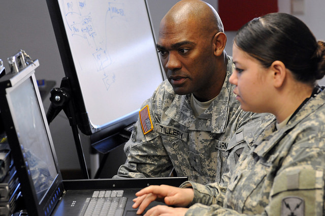Warrent Officer Mike Tillery watches as Spc. Christine Kaipat sets up a connection during Cyber Endeavor, a smaller exercise within Combined Endeavor 11 in Grafenwoehr, Germany, Sept. 14 2011.