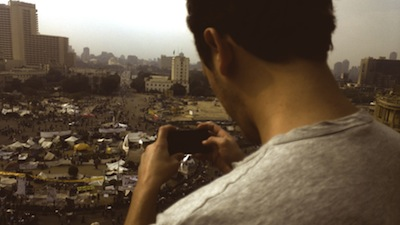 Jonas Vig of Bambuser livestreaming via his mobile phone above Tahrir Square in downtown Cairo days before the November 2011 elections.