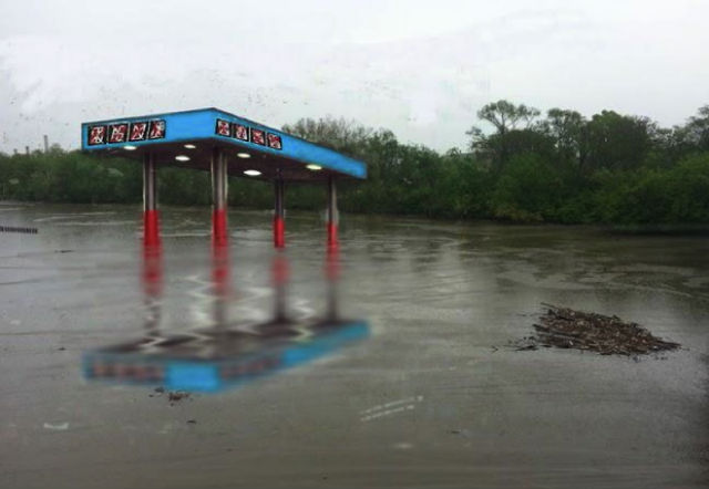 """A rendering of Mia Feuer's proposed public art piece, """"Antediluvian,"""" a sunken gas station sculpture in the Anacostia River."""