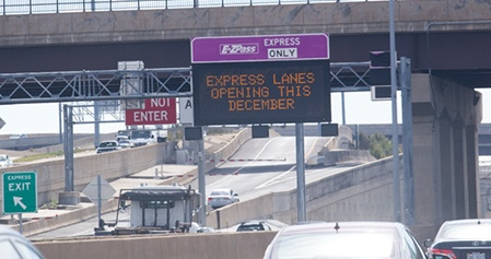 A sign in Springfield advertises the opening of the I-95 Hot Lanes this month.