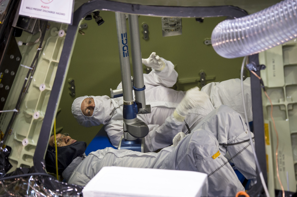 NASA Administrator Charles Bolden, foreground, and Scott McDade of Lockheed Martin inspect the Orion Multipurpose Crew Vehicle in November 2013 before its first test flight.