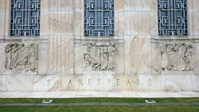 "At center is the ""Julius Caesar"" bas-relief on the exterior of the Folger Shakespeare Library."