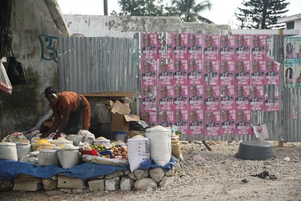 A photo from Kojo's trip to Port-au-Prince in November 2010. Campaign signs for the president, who five years later is delaying elections, are seen in the background.