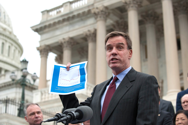 Warner speaks during a Democratic rally against the October 2013 government shutdown.