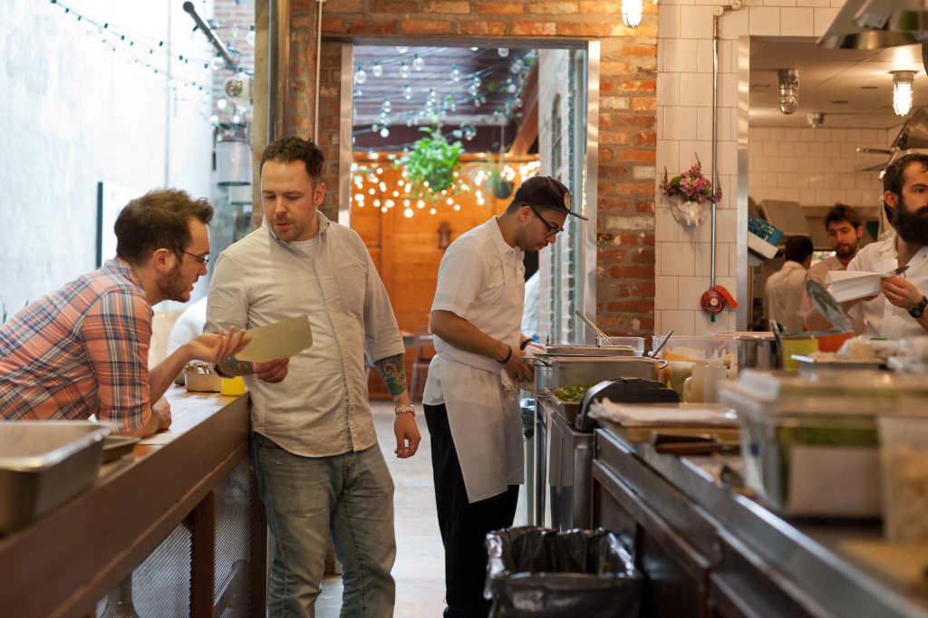 Rose's Luxury chef Aaron Silverman (second from left) prepares the menu for March 16, 2015.