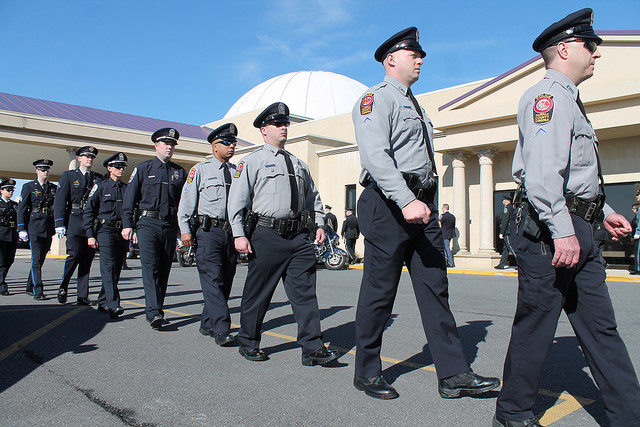 Maryland police officers at a funeral service for Police Officer Brennan Rabain in March, 2015