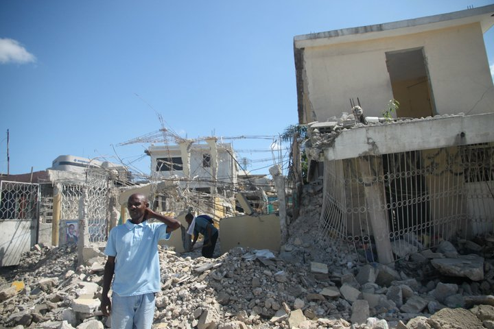 Haitians in Port-au-Prince dig through rubble in November 2010, months after the earthquake that leveled so much of the country's capital city.
