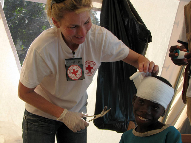 Monika Hörling, a nurse from the Swedish Red Cross, takes care of a patient in the Finnish Red Cross mobile health clinic in Port-au-Prince, Haiti January 21, 2010.
