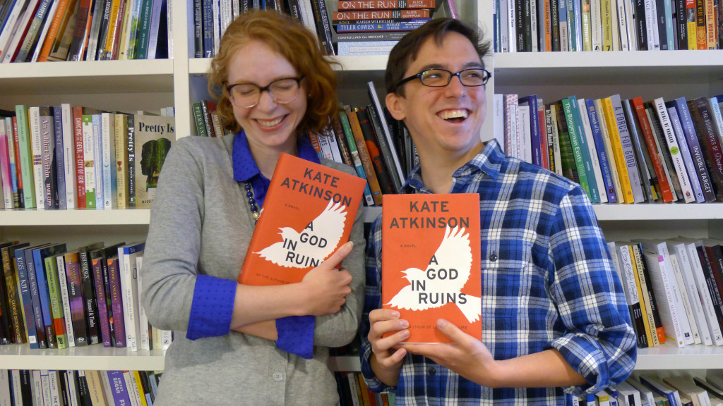 "Kojo Show producer Tayla Burney (left) and WAMU web producer Chris Chester (right) pose with ""A God In Ruins,"" one of Burney's summer reading picks and a feature of this year's Morning Edition Book Club."