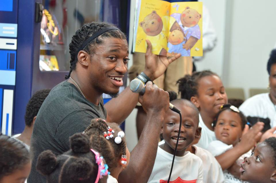 Washington Redskins quarterback Robert Griffin III reads to children in Southeast, D.C.
