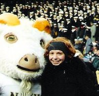 Kojo Show producer Tayla Burney with Navy mascot Bill The Goat at the 2002 Army-Navy game.