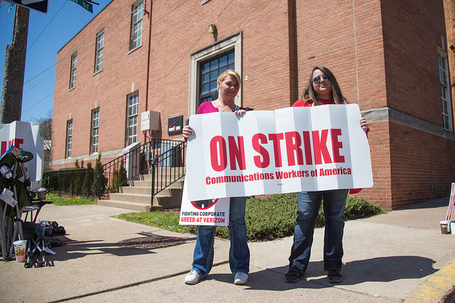 Members of CWA Local 13500 picket outside of the Verizon building at Third and Center Streets in Bloomsburg, Pa.