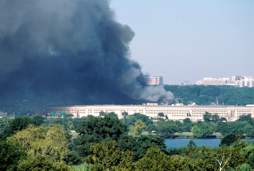 Clouds of smoke billow out of the Pentagon after a hijack airline crashed into it on September 11, 2001.