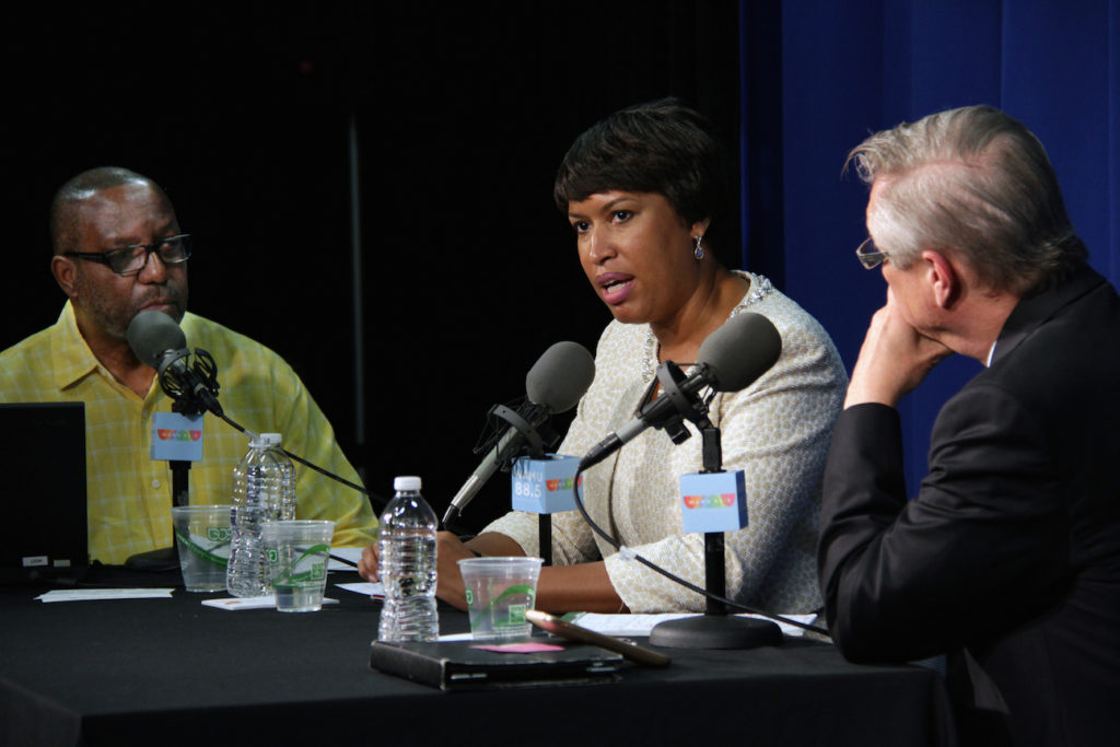 Mayor Muriel Bowser with host Kojo Nnamdi (left) and political analyst Tom Sherwood (right) on Politics Hour in 2015.