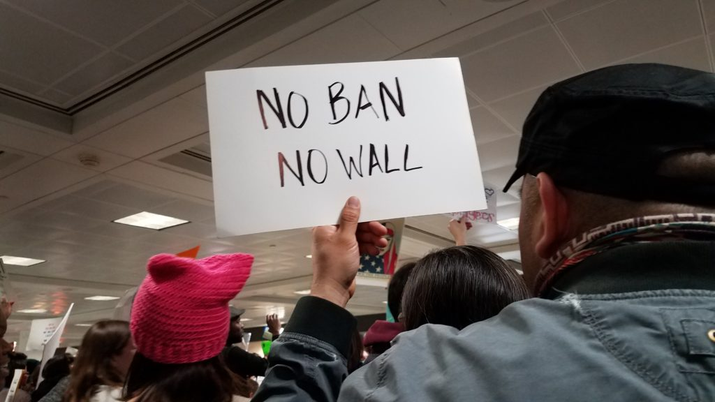 Protestors flocked to Dulles International Airport to protest President Trump's immigration order banning immigration from seven predominately-Muslim countries.