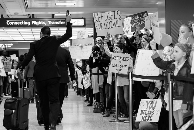 Protestors against Trump's immigration ban welcome incoming travelers to Dulles International Airport over the weekend.
