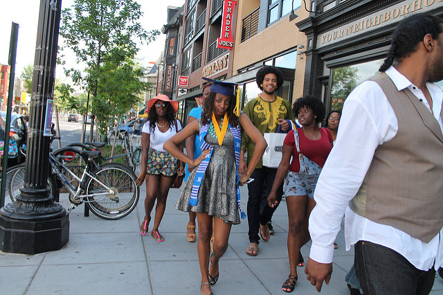 A Howard University Class of 2015 graduate struts down 14th Street in Northwest D.C.
