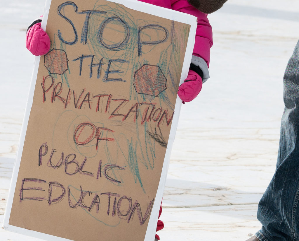 A child protesting the confirmation of Betsy DeVos as U.S. Secretary of Education.