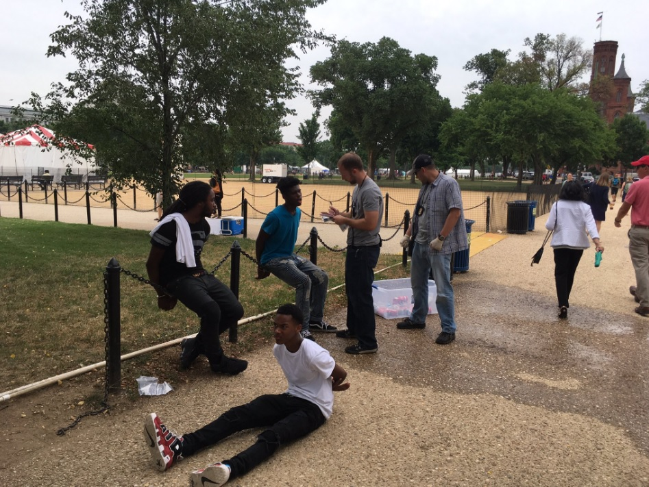 The U.S. Park Police handcuffed young black men on the National Mall  on Friday for selling water bottles.