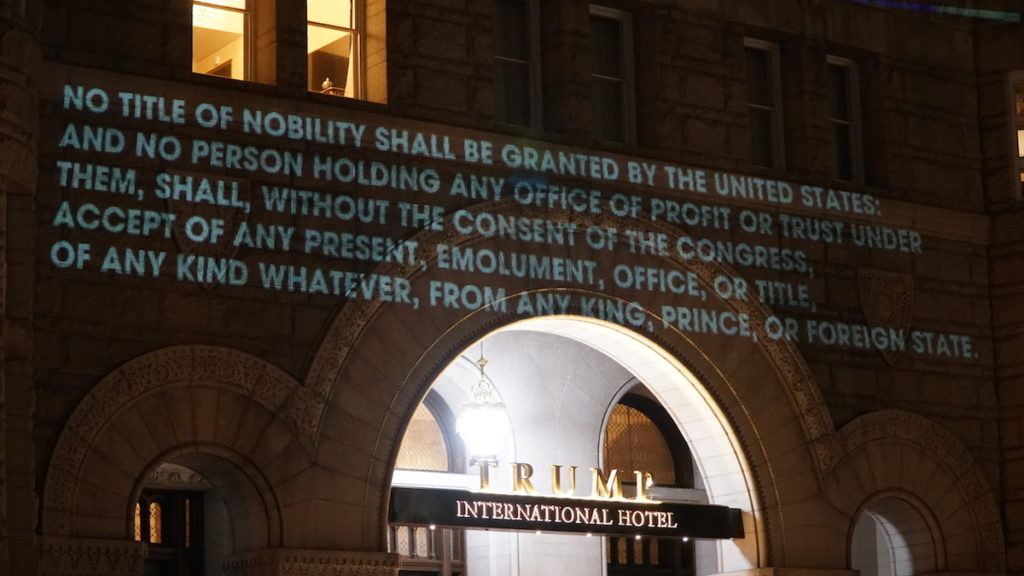 D.C. artist Robin Bell's protest outside Trump's D.C. hotel alleging a violation of the Emoluments Clause.