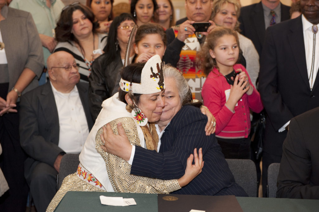 Natalie Proctor and Mervin Savoy, both of the Piscataway-Conoy Confederacy, embrace at a 2012 ceremony to celebrate Maryland's recognition of two tribes of Piscataway Indians.
