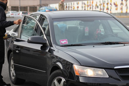 A Lyft driver drops off a passenger near Union Station