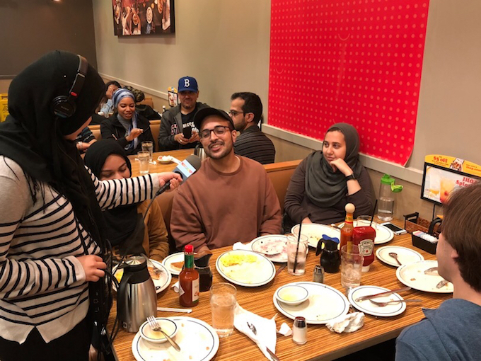 Dayana Mustak,a producer on the Kojo Nnamdi Show, talking to local Muslims during an early morning meal at IHOP in Columbia Heights.