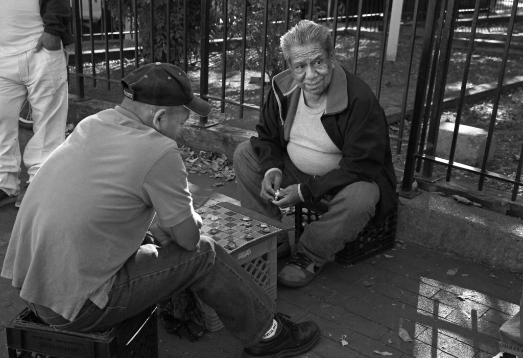 Local residents gather for a game of checkers on the corner between Mount Pleasant and Kenyon streets in D.C.