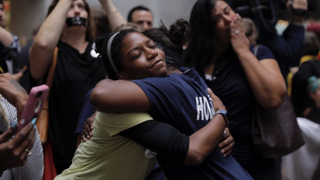 Women embrace at a protest outside the Kavanaugh hearing.