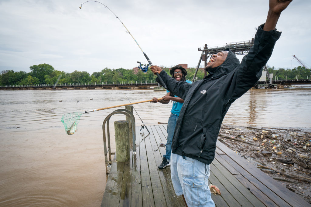 On the Anacostia River, William Mitchener catches his first fish with cousin Byron Coleman