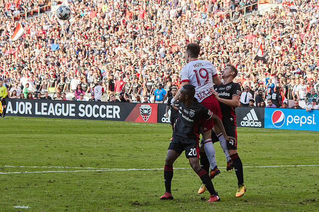 D.C. United players Jalen Robinson (left) and Russell Canouse (right) jostle for position with New York Red Bulls midfielder Alex Muyl in a match at RFK Stadium on October 22, 2017.