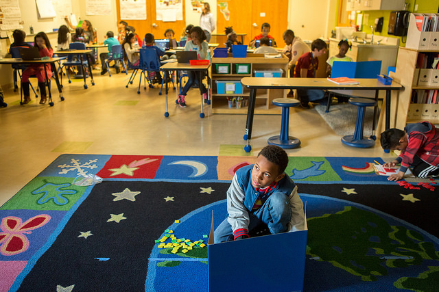 A third grade student works at a math station at Capital City Public Charter.