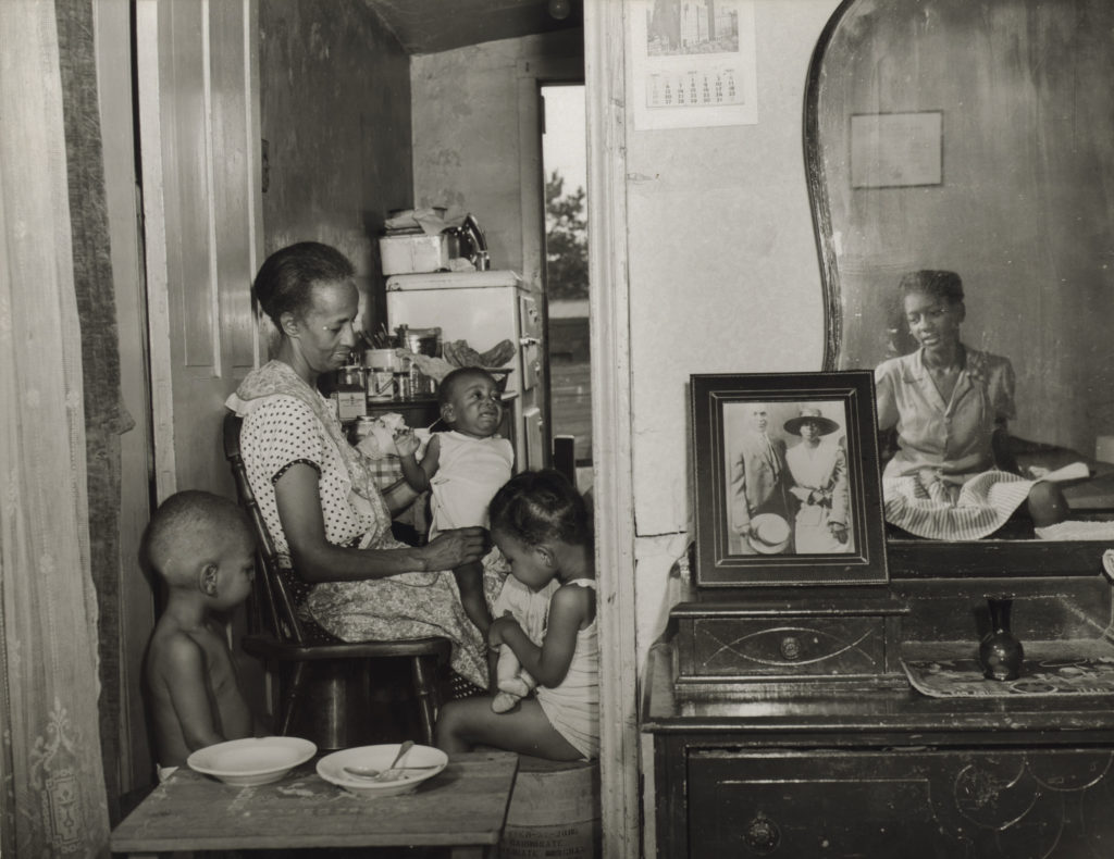 Gordon Parks. <i>Washington, D.C. Mrs. Ella Watson, a government charwoman, with three grandchildren and her adopted daughter</i>, July 1942.