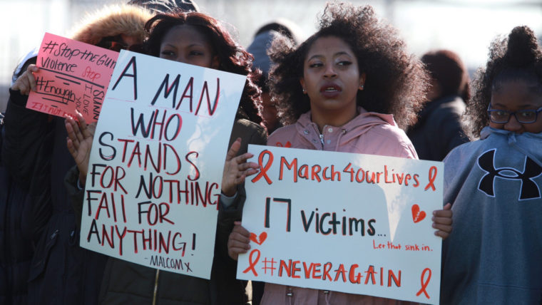 Students from Eastern High School in D.C. hold signs called for action on gun violence during a school walkout on March 14, 2018,