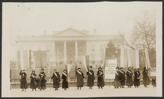 Female suffragists picket in front of the White House in 1917.