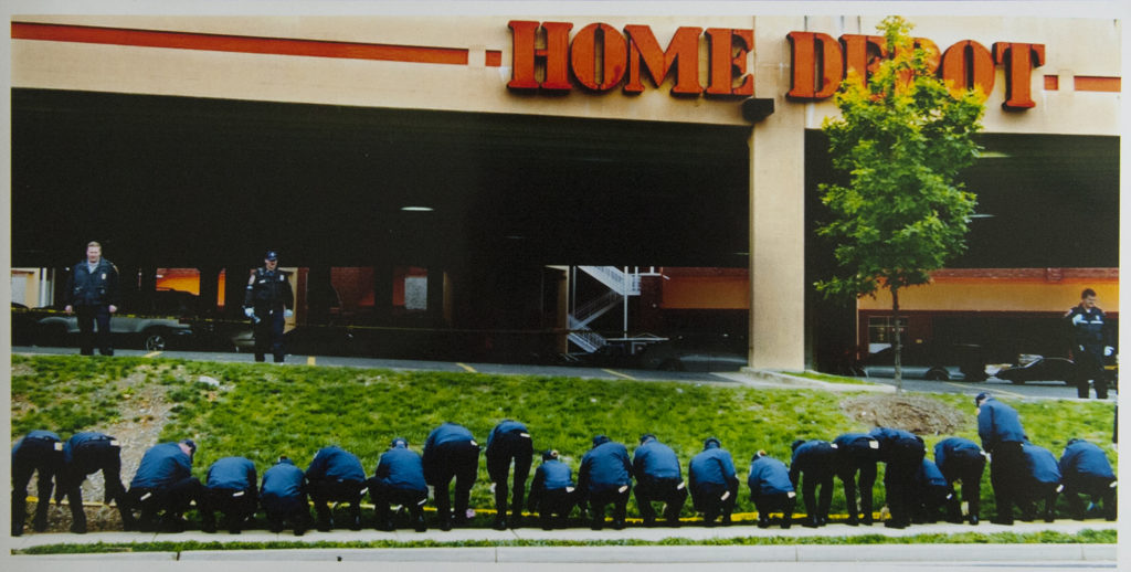 "Police cadets line up for a ""grid search"" at the site of a sniper shooting at a Home Depot in Falls Church, Va."