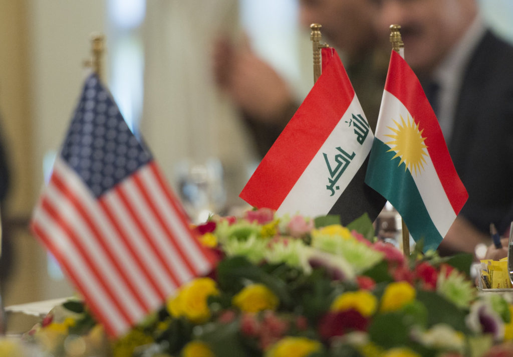 The Flags of the United States, Iraq, and Iraqi Kurdistan are on display during a meeting between Marine Gen. Joseph F. Dunford Jr., chairman of the Joint Chiefs of Staff, and the President of Iraqi Kurdistan Masoud Barzani, at the Kurdish White House April 22nd, 2016.