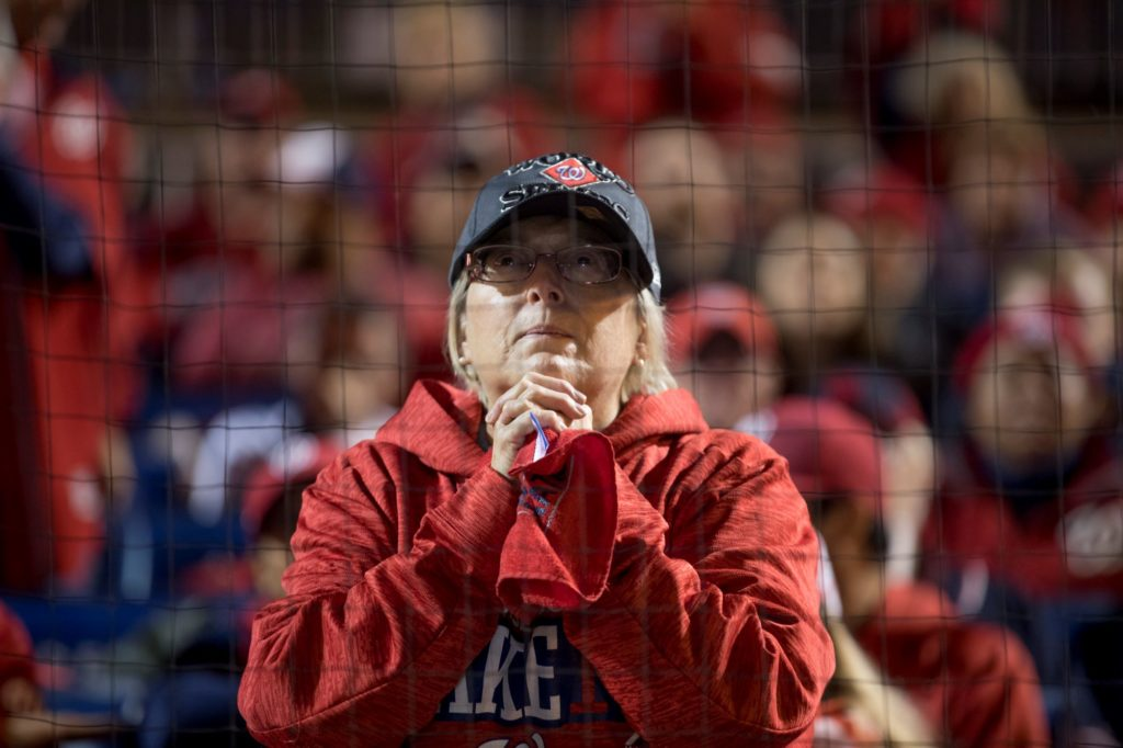 One fan looks on nervously from Nationals Park as the team looks to eke out its first win in the World Series.