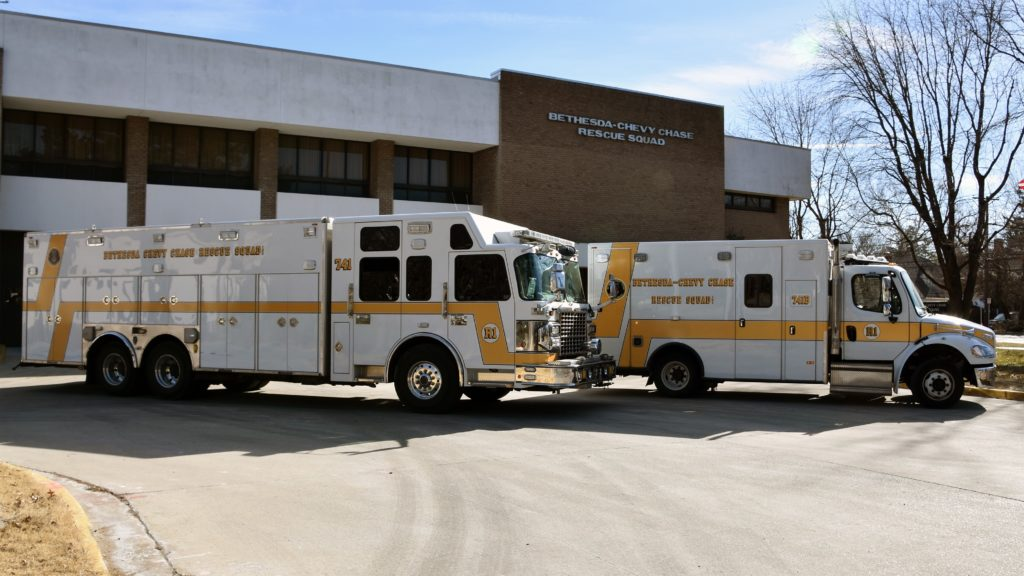 A heavy rescue truck and an ambulance sit outside the Bethesda-Chevy Chase Rescue Squad. Beginning as a one-ambulance department in 1937, the Rescue Squad now has over 150 professionally trained volunteers.