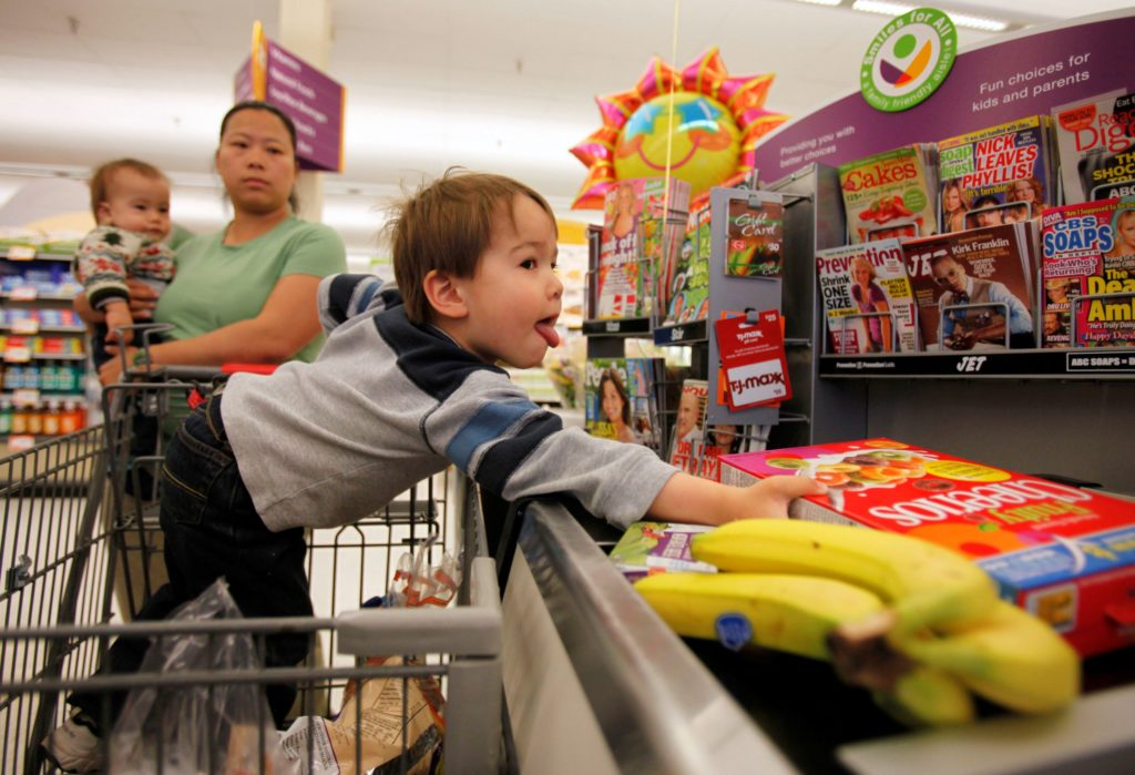 A mother shopping with her children at a Giant supermarket in Chevy Chase, Maryland, on April 6, 2009