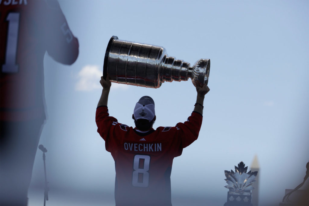 Alex Ovechkin raises the Stanley Cup at the Capitals victory parade in June 2018.
