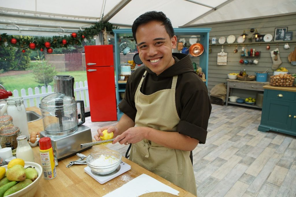 Brother Andrew Corriente, a Capuchin Franciscan friar who is studying for the priesthood at Catholic University, competing at The Great American Baking Show. He won the 2020 holiday edition of the show.