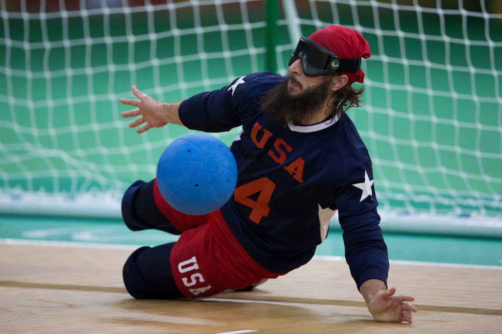 John Kusku of the United States, works to block the ball during the men's preliminary round Group B goalball match against China, during the Rio 2016 Paralympic Games, at Future Arena, in Rio de Janeiro, Brazil, Friday, Sept. 9, 2016. United States won 5-2.