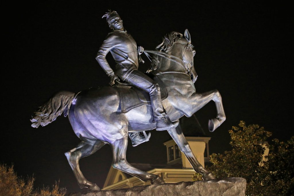 """""""Rumors of War"""" by artist Kehinde Wiley shows a young black man astride a galloping horse. It has been permanently installed in Virginia's capital city, not far from the Confederate monuments it mimics."""