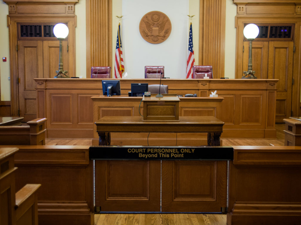 How have the local courts, correctional facilities and law firms reacted to the coronavirus pandemic?