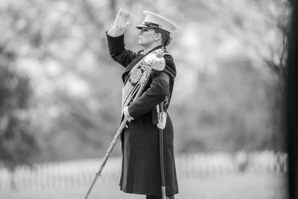 """Assistant Drum Major Gunnery Sgt. Stacie Crowther conducts The United States Marine Band, """"The President's Own"""" during the full honors funeral of U.S. Marine Corps. Pvt. Archie Newell in Section 60 of Arlington National Cemetery, Arlington, Va., Dec. 8, 2017."""