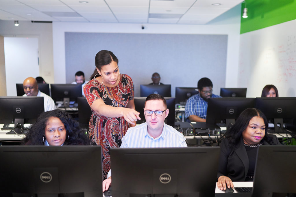 An instructor with the D.C.-based non-profit group Byte Back and her class. The group offers free basic and more advanced computer skills classes to adults so they can find jobs.