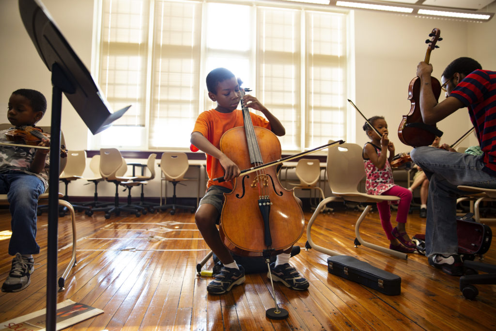 A D.C. Youth Orchestra student practices his cello.