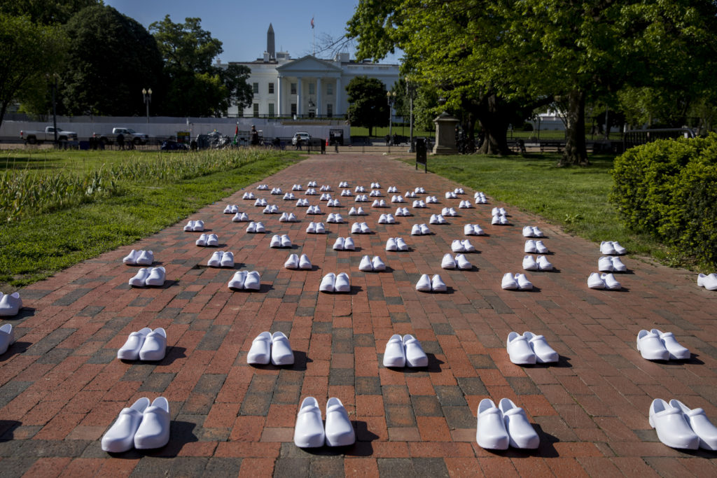 Pairs of white shoes represent the nurses who lost their lives to the coronavirus.