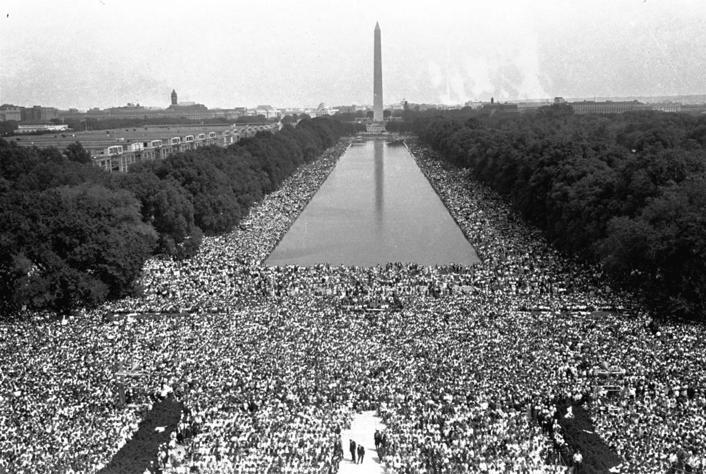 Crowds are shown in front of the Washington Monument during the 1963 March on Washington for Jobs and Freedom, August 28, 1963.